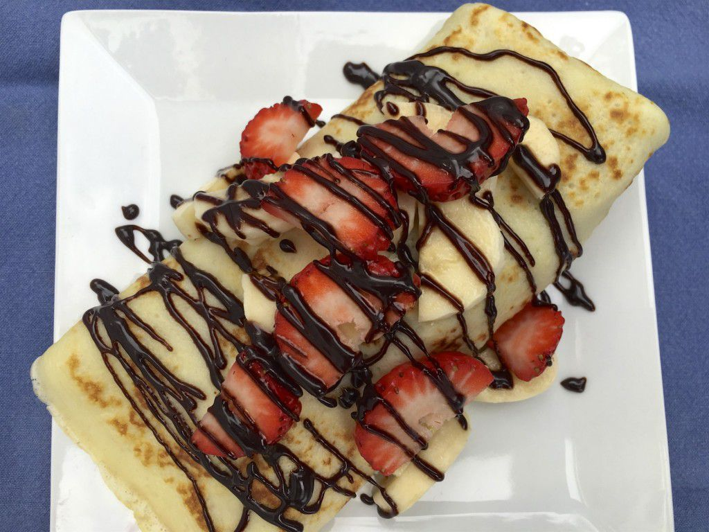 crepes with strawberries, bananas and chocolate peanut butter sauce